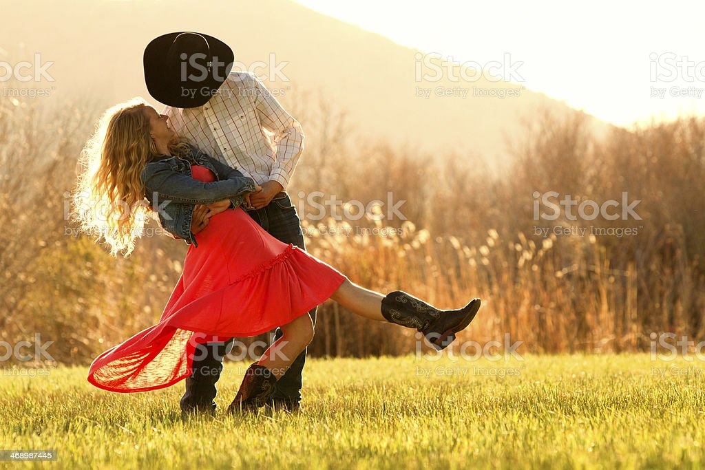 Redneck Romeo with His Tan Legged Juliet stock photo