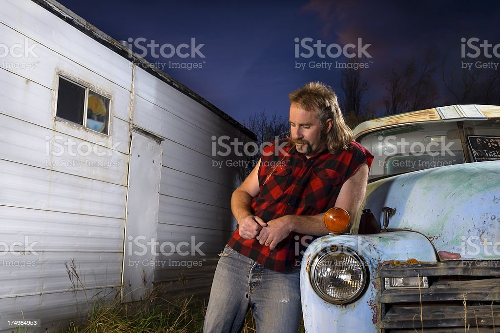 Redneck Thinking and Worried While Down on His Luck stock photo