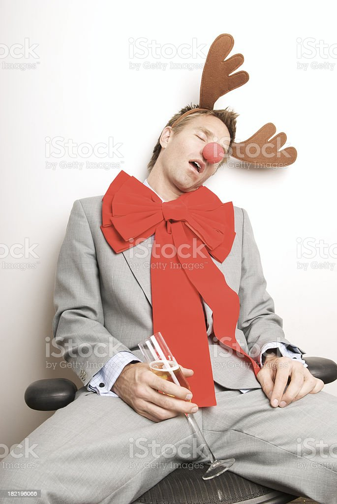 Red-Nosed Reindeer Guy Passes Out at Holiday Office Party stock photo