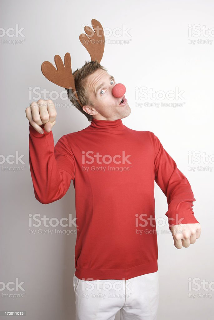Red-Nosed Reindeer Holiday Man Paws the Air stock photo