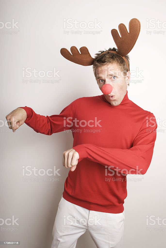 Red-Nosed Reindeer Man Prances at White Wall stock photo