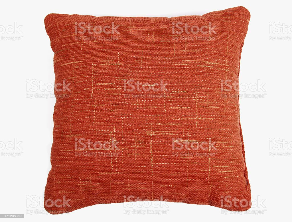 Red-orange square couch pillow with yellow design  stock photo