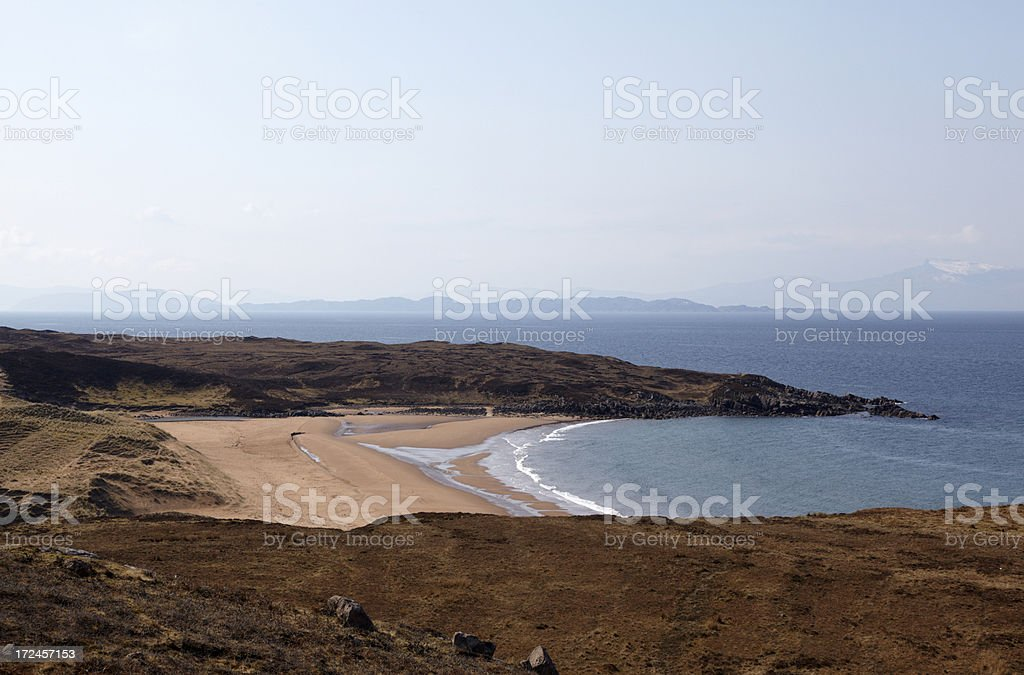 Redpoint Bay with the Isle of Skye in background stock photo