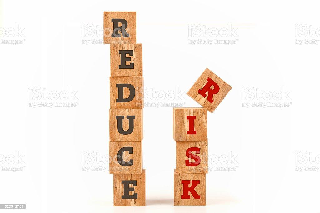 Reduce Risk word written on cube shape stock photo