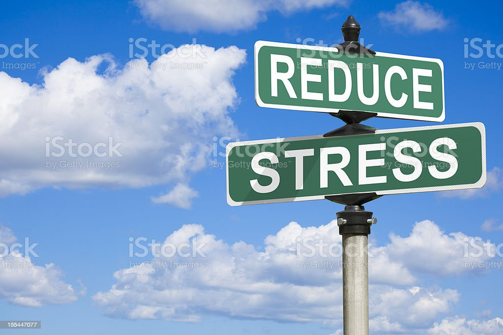 Reduce Stress Street Sign stock photo