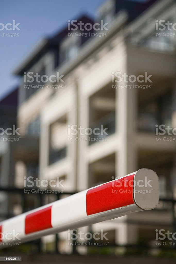 Red-white barrier, protecting apartment entrance stock photo