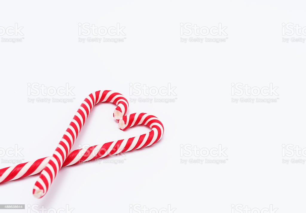 Red-white candy canes in shape of heart stock photo