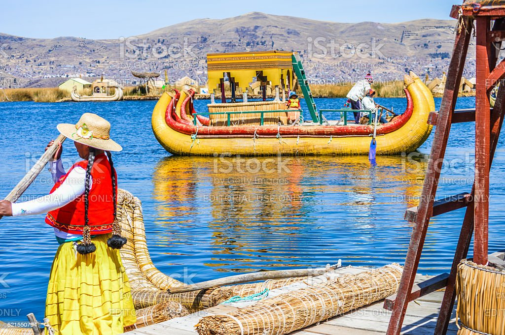 Reed boat in Puno, Peru with indigenous people stock photo
