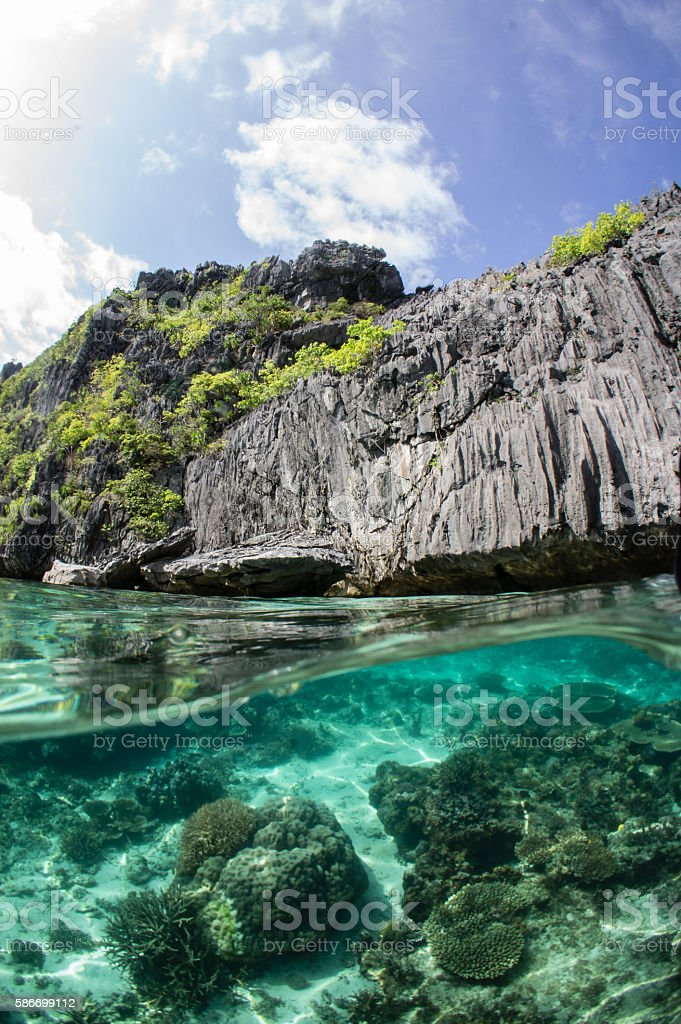 Reefs and cliffs over and under the sea stock photo