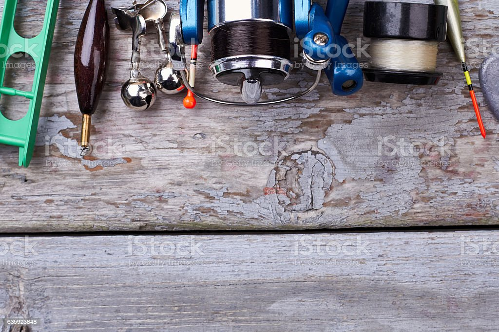 Reel and bobber on wood. stock photo