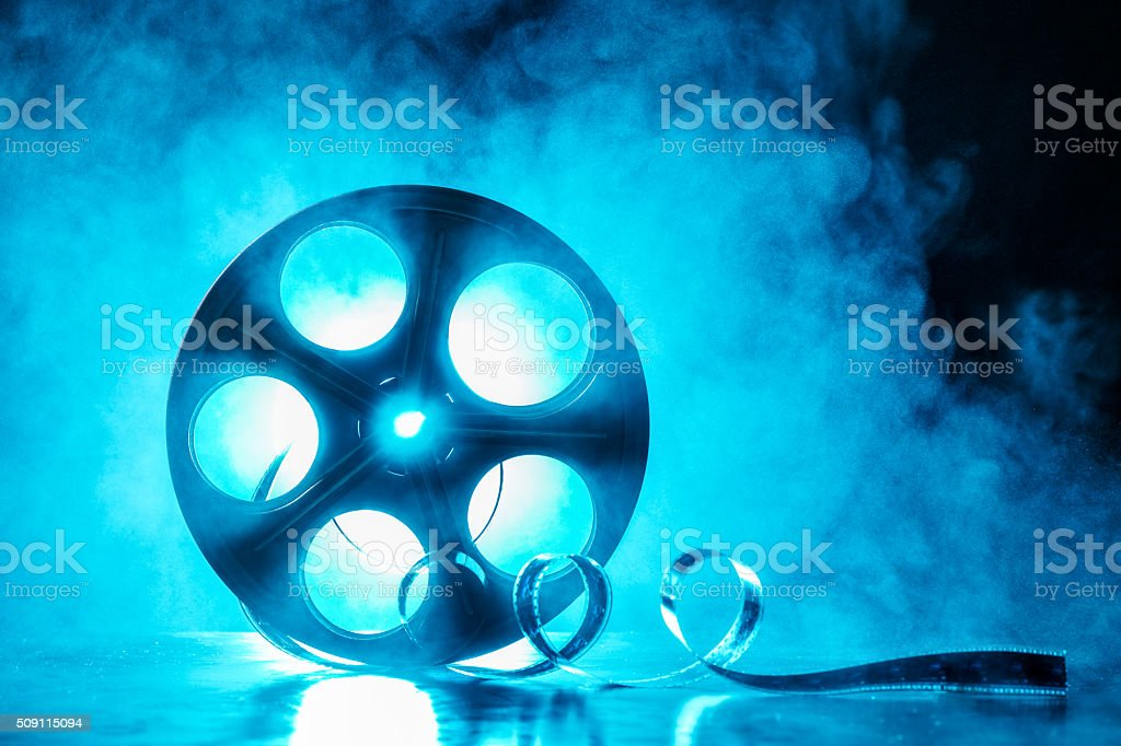 Reel of film with smoke and backlight stock photo