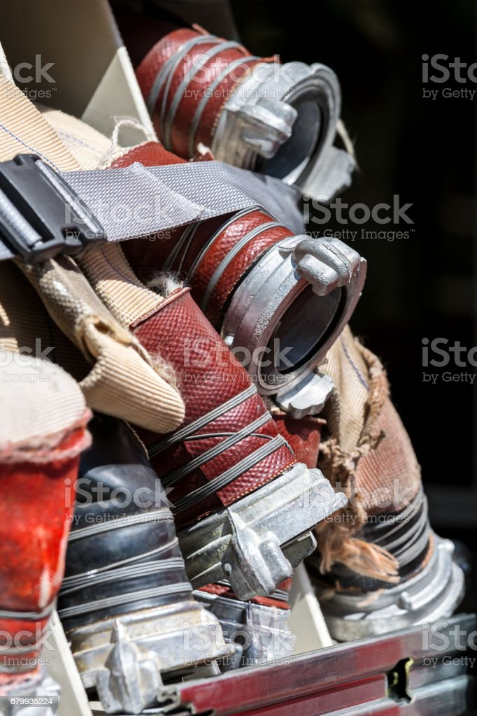 reeled up fire hoses of rescue firefighting truck stock photo