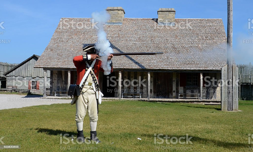 Re-enactor fires musket at Fort Michilimackinac stock photo