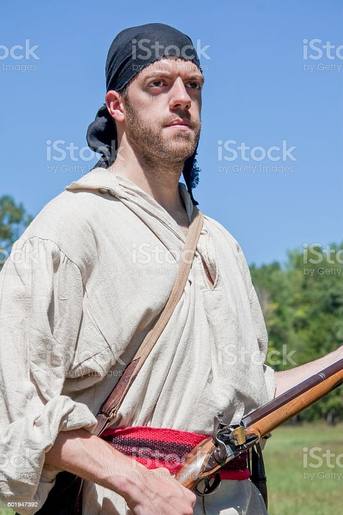 Reenactor Portraying An Indian With Rifle, French and Indian War stock photo