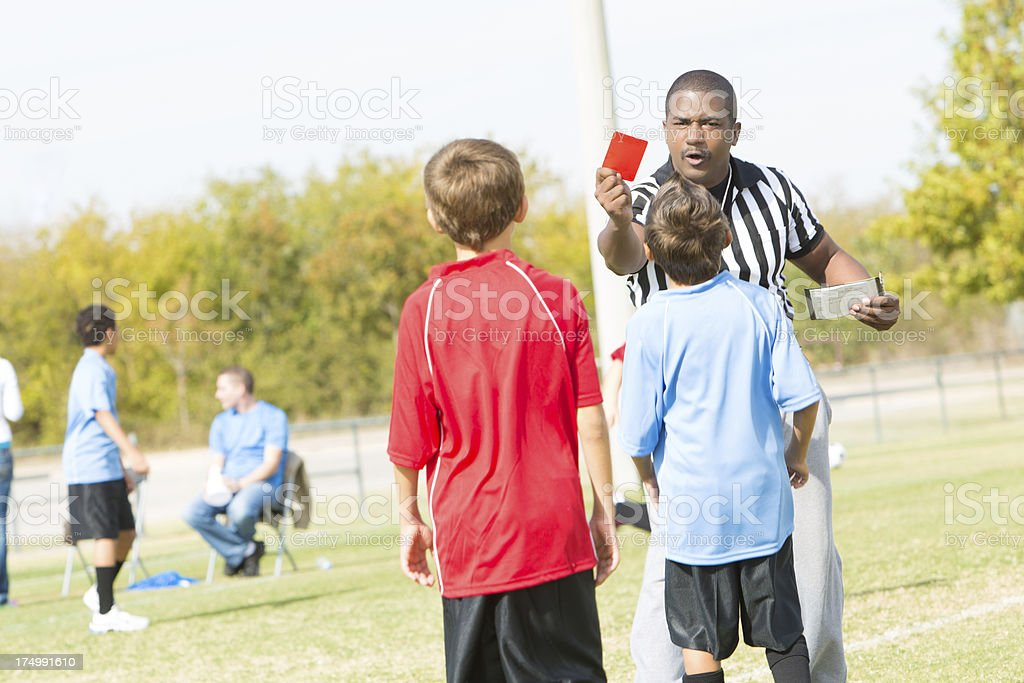 Ref giving a penalty red card at youth soccer game royalty-free stock photo