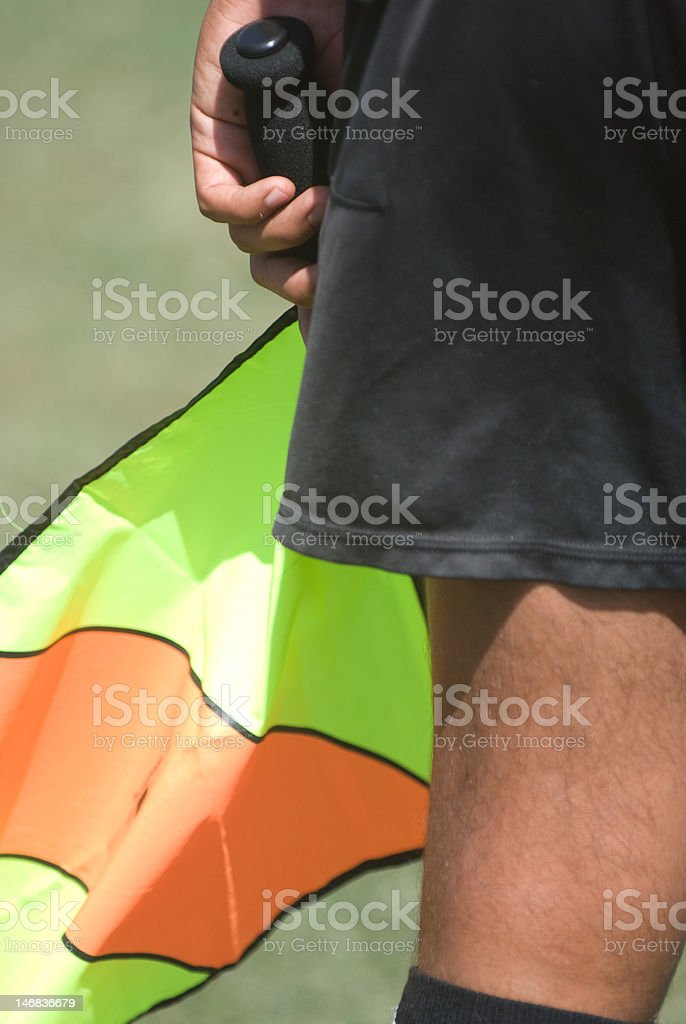 Referee and Flag royalty-free stock photo