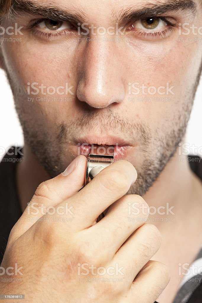 Referee blowing his whistle stock photo