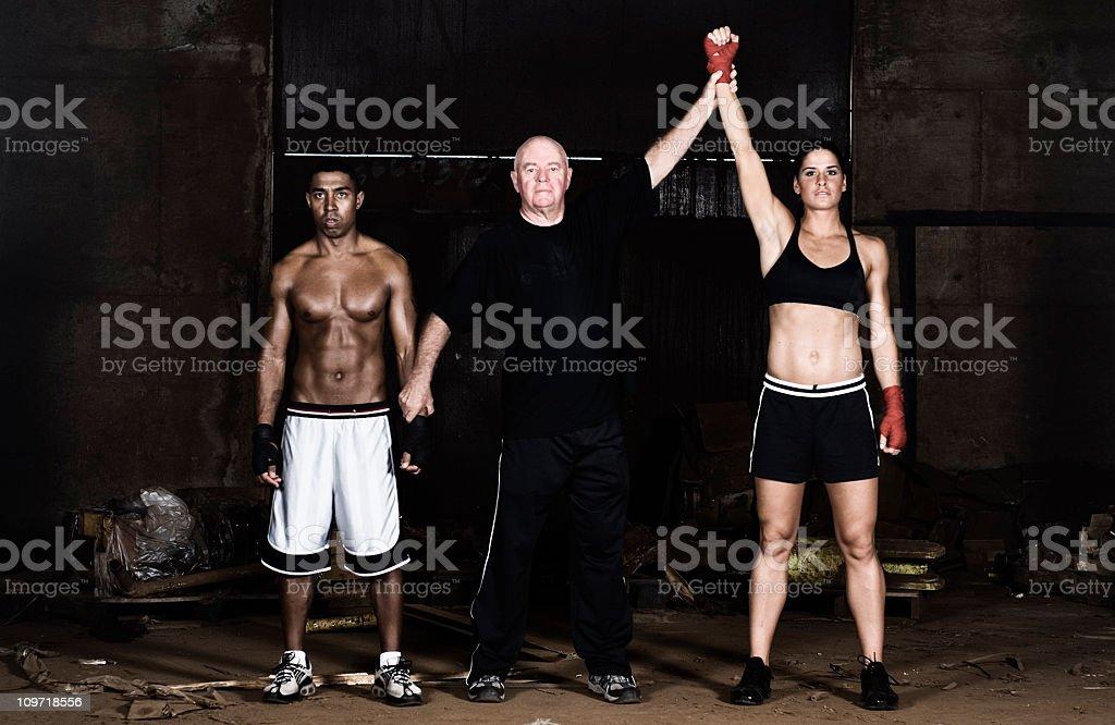 Referee Declaring Boxing Match Female Winner stock photo
