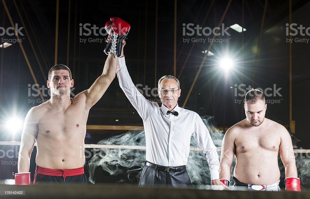 Referee declaring boxing match winner. stock photo