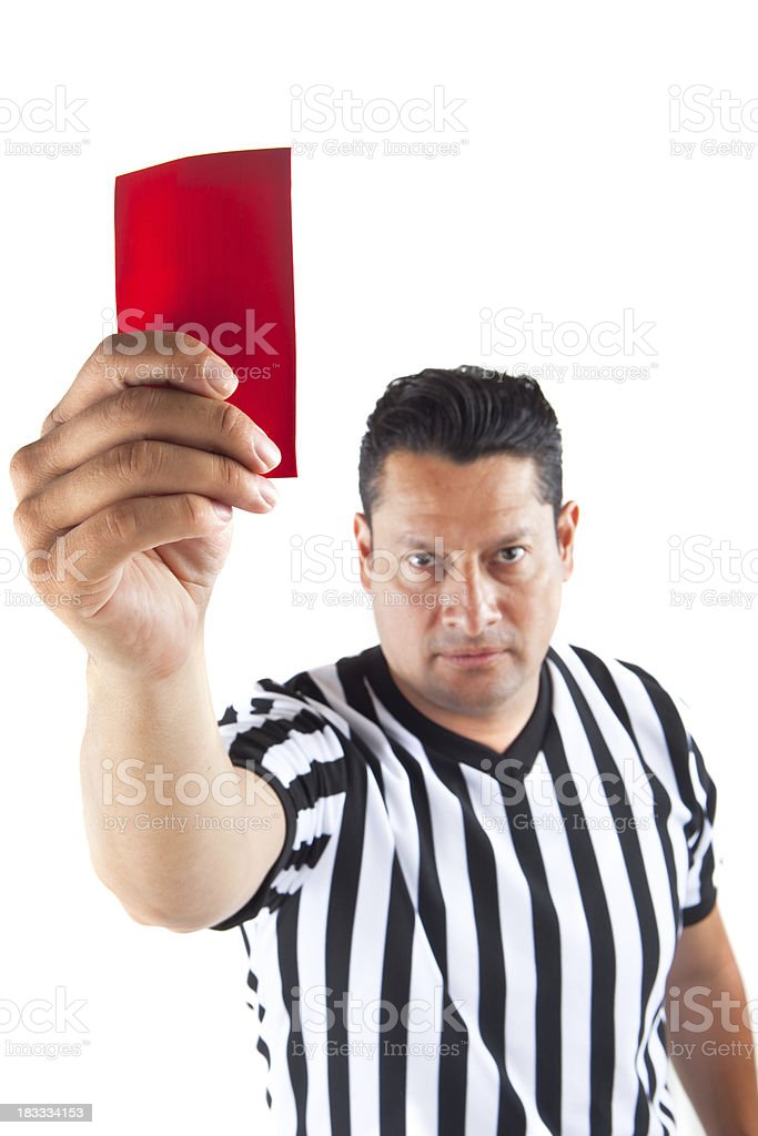 referee holding red card up stock photo