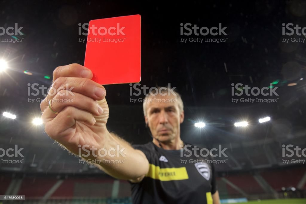 Referee holds up red card stock photo