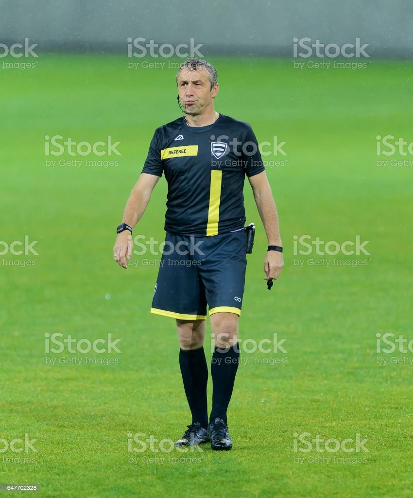 Referee looking away stock photo