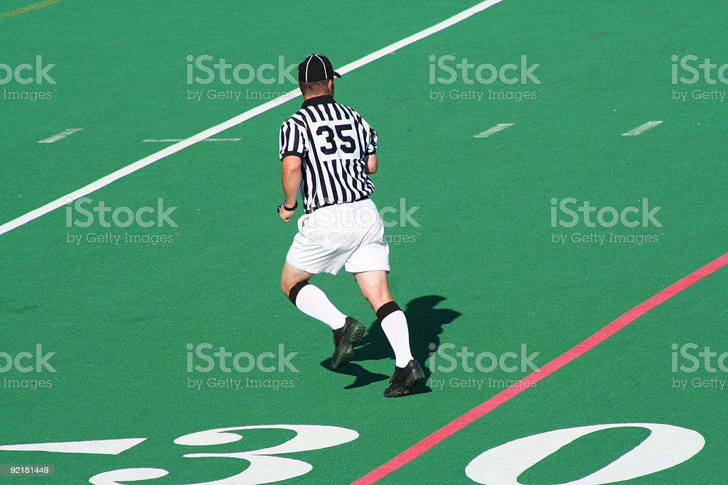 referee midstride stock photo