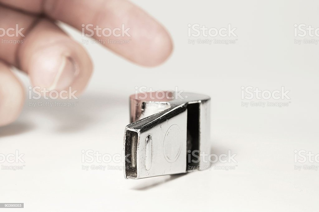Referee picking up whistle royalty-free stock photo