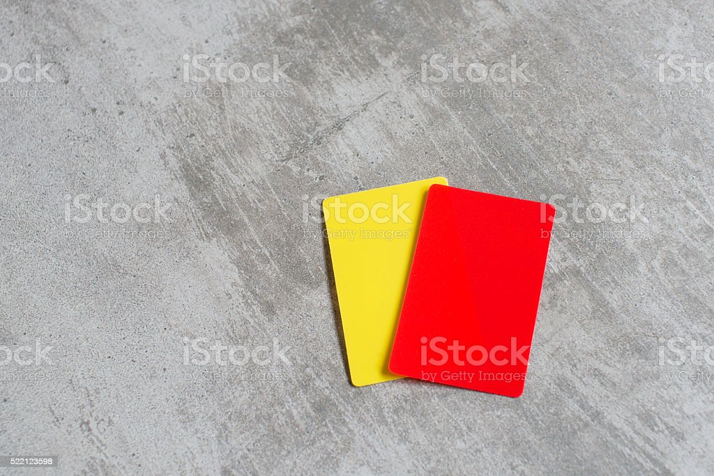 Referee red and yellow card stock photo