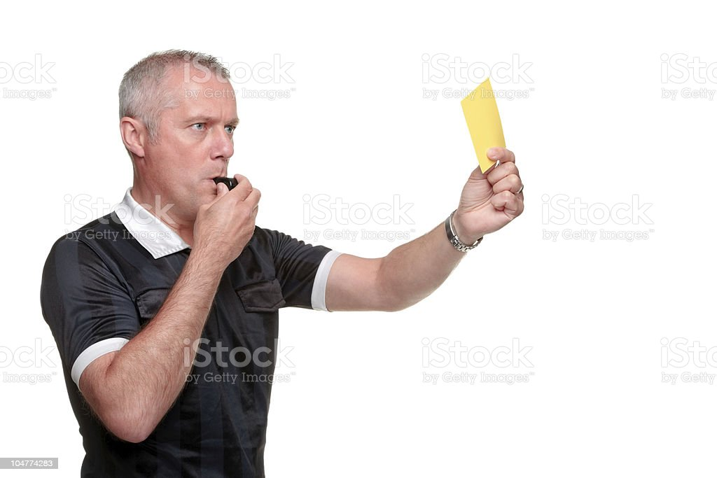 Referee showing the yellow card side profile stock photo