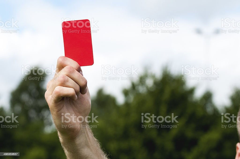 Referee shows a red card stock photo