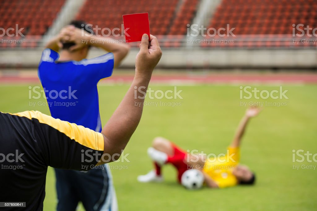 Referee soccer show card for warning and  recorded player foul stock photo