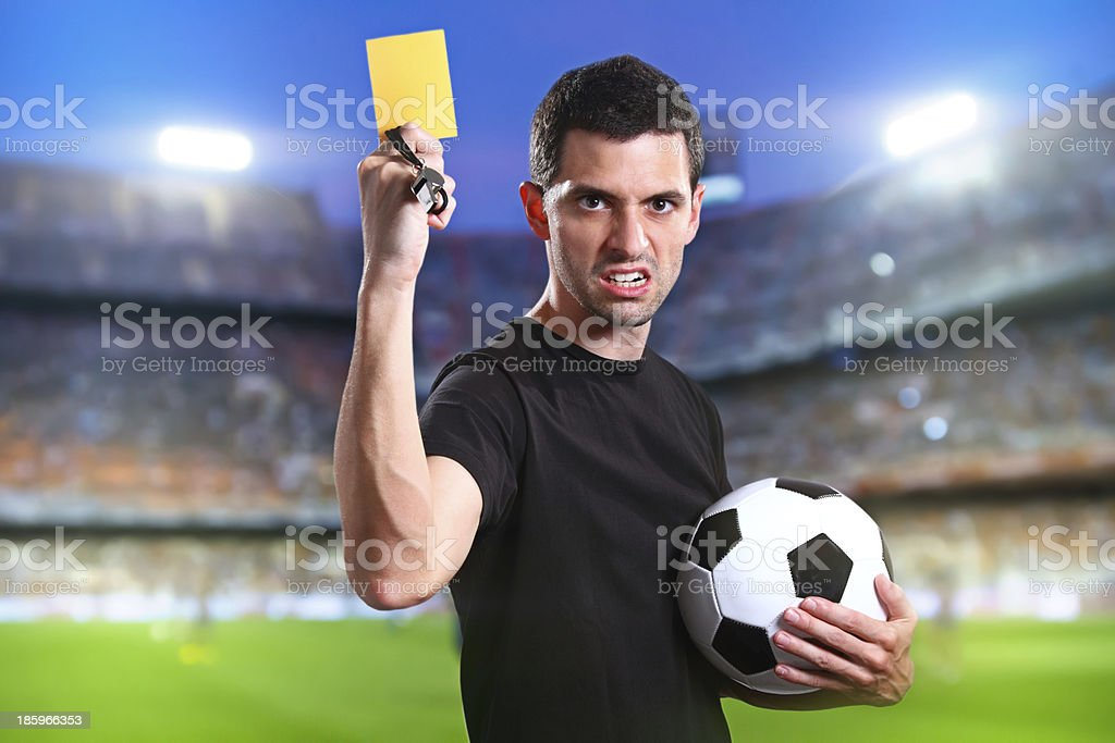 Referee with yellow card stock photo