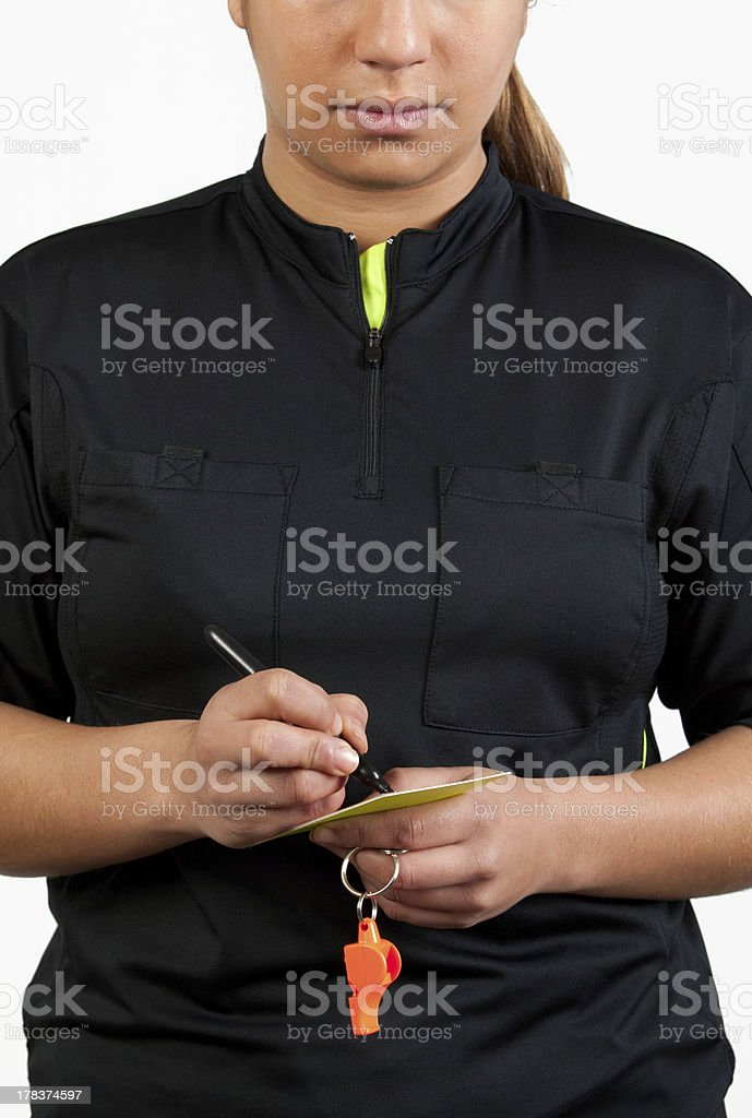 referee writing on the card royalty-free stock photo