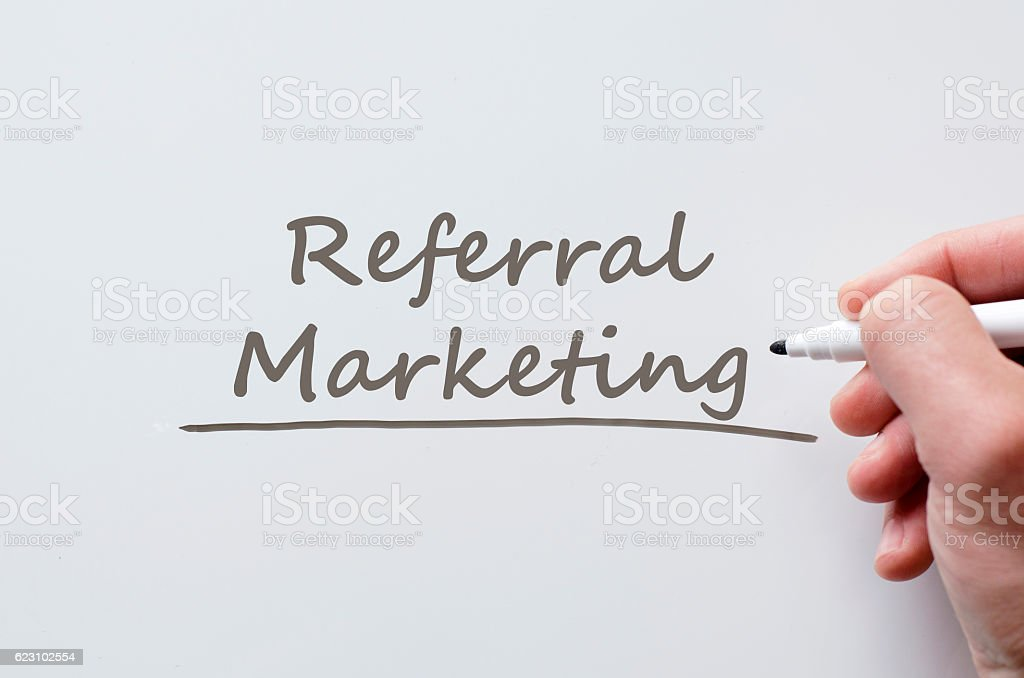 Referral marketing written on whiteboard stock photo