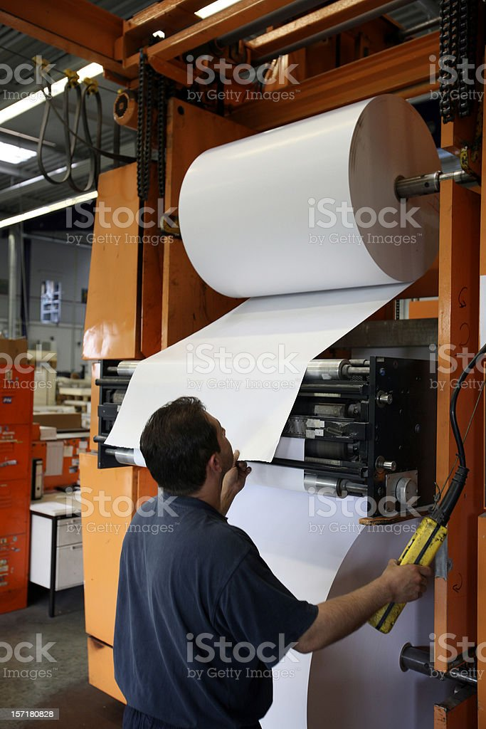 Refilling huge paper roll royalty-free stock photo