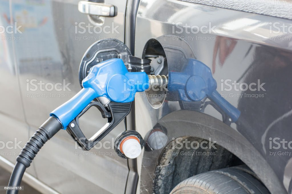 Refilling the car with fuel stock photo
