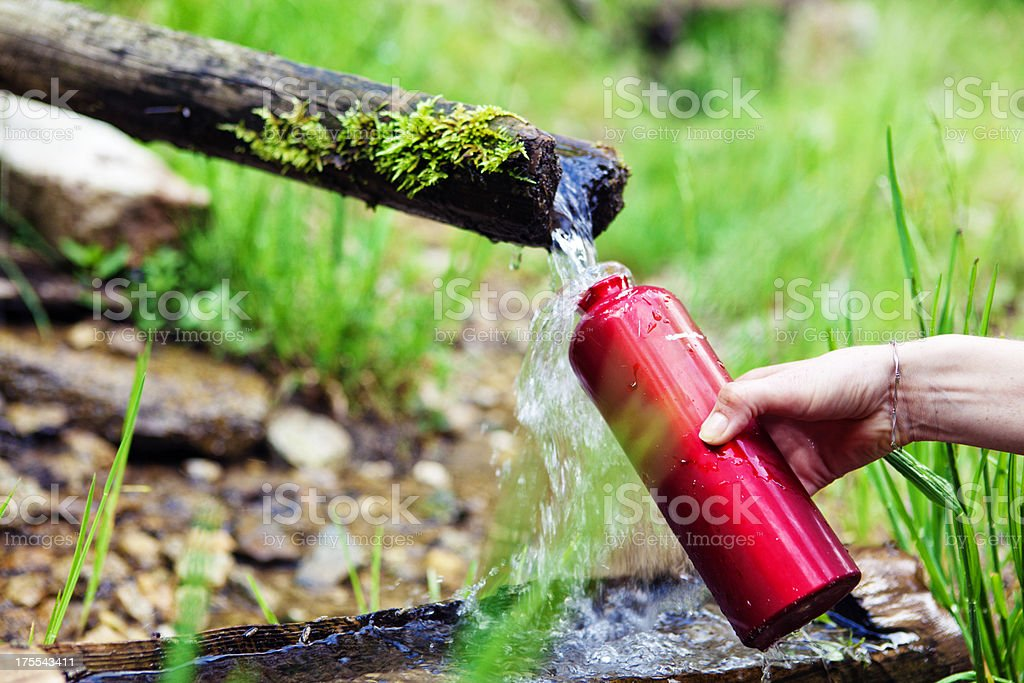 refilling the water canteen royalty-free stock photo