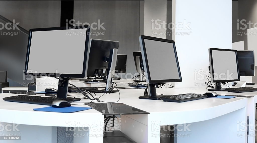 Refined photo of several LCD computer monitors within office interior stock photo