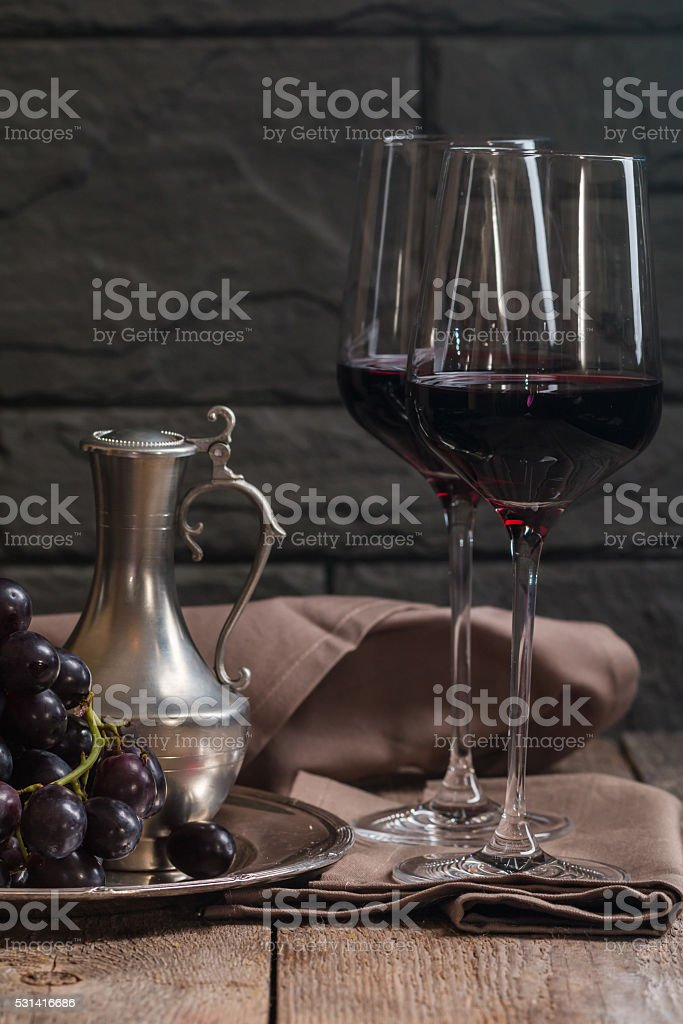 Refined still life of red wine and grapes stock photo