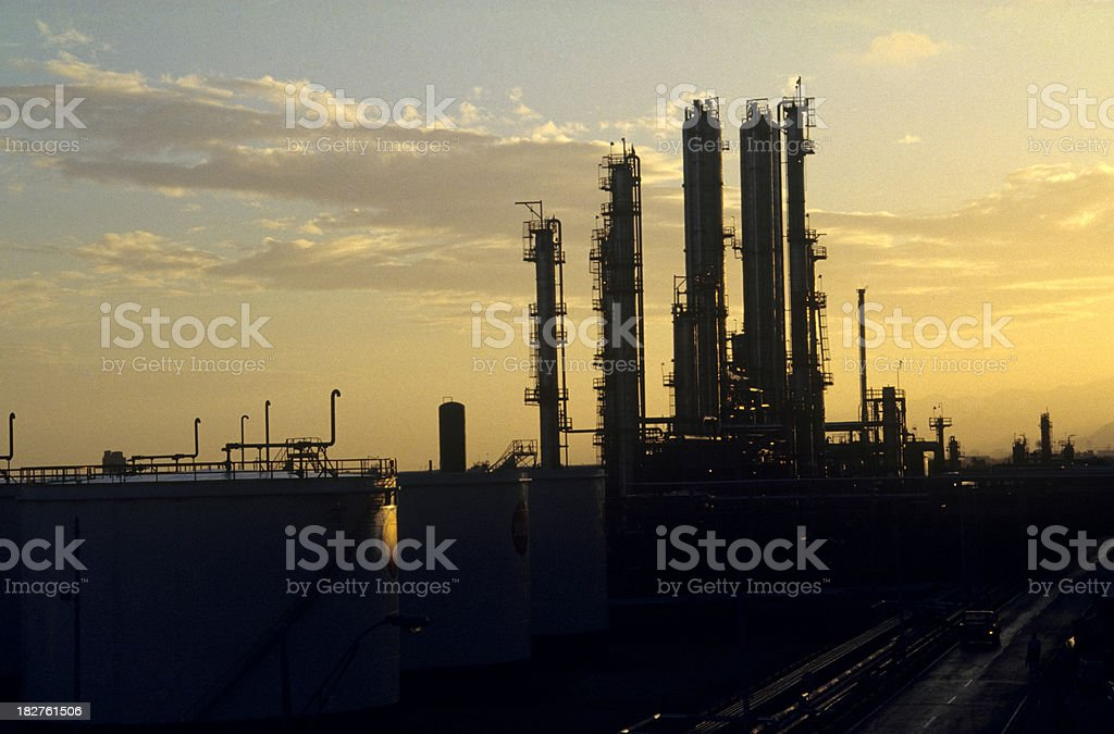 refinery at sunset royalty-free stock photo