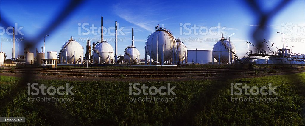 Refinery Behind Fence stock photo