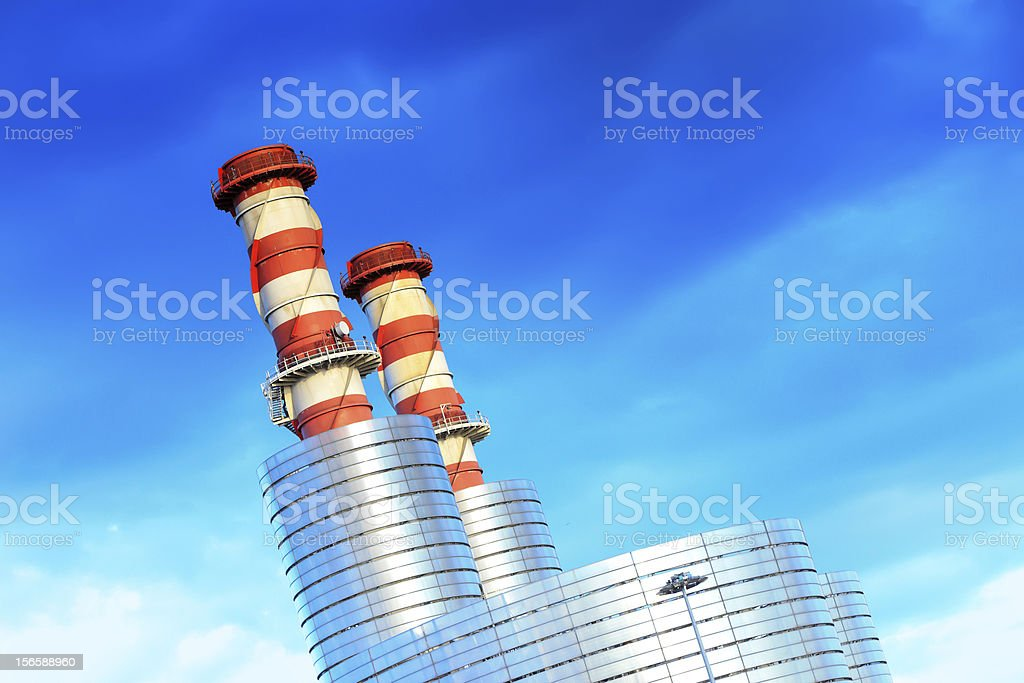 Refinery complex chimneys royalty-free stock photo