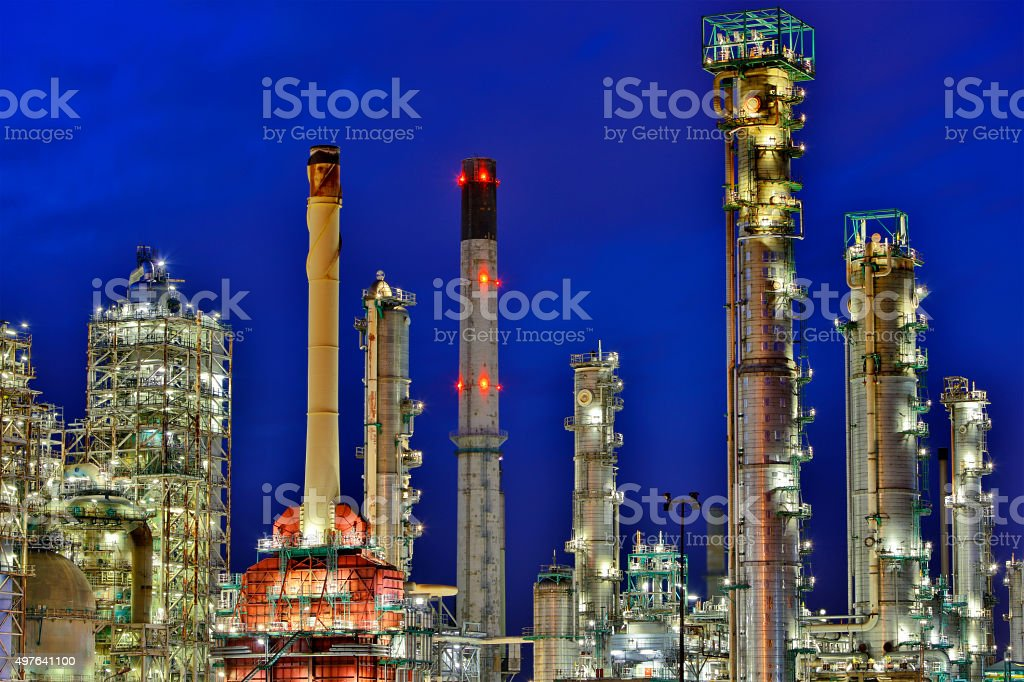 Refinery Illuminated at Dusk stock photo