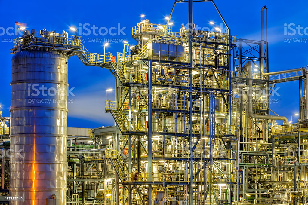 Refinery Illuminated at Night stock photo