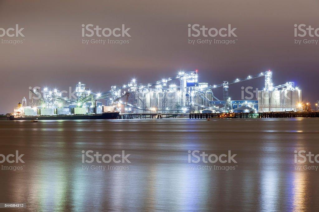 Refinery illuminated at night stock photo