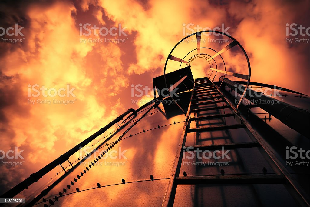 Refinery ladder under evil sky royalty-free stock photo