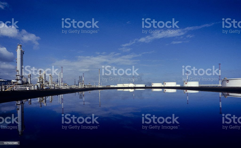 refinery reflected in the blue royalty-free stock photo