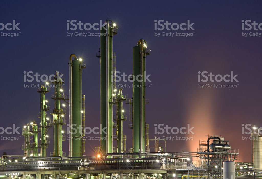 Refinery Towers With Purple Sky royalty-free stock photo