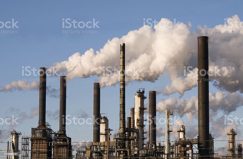 refinery with smoke stacks stock photo